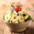 Tortellini with cheese sauce — Stock Photo