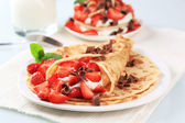 Crepes with cheese and strawberries — Stock Photo