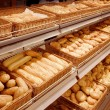 Variety of baked products at a supermarket — ストック写真