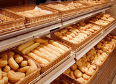 Variety of baked products at a supermarket — Stock Photo