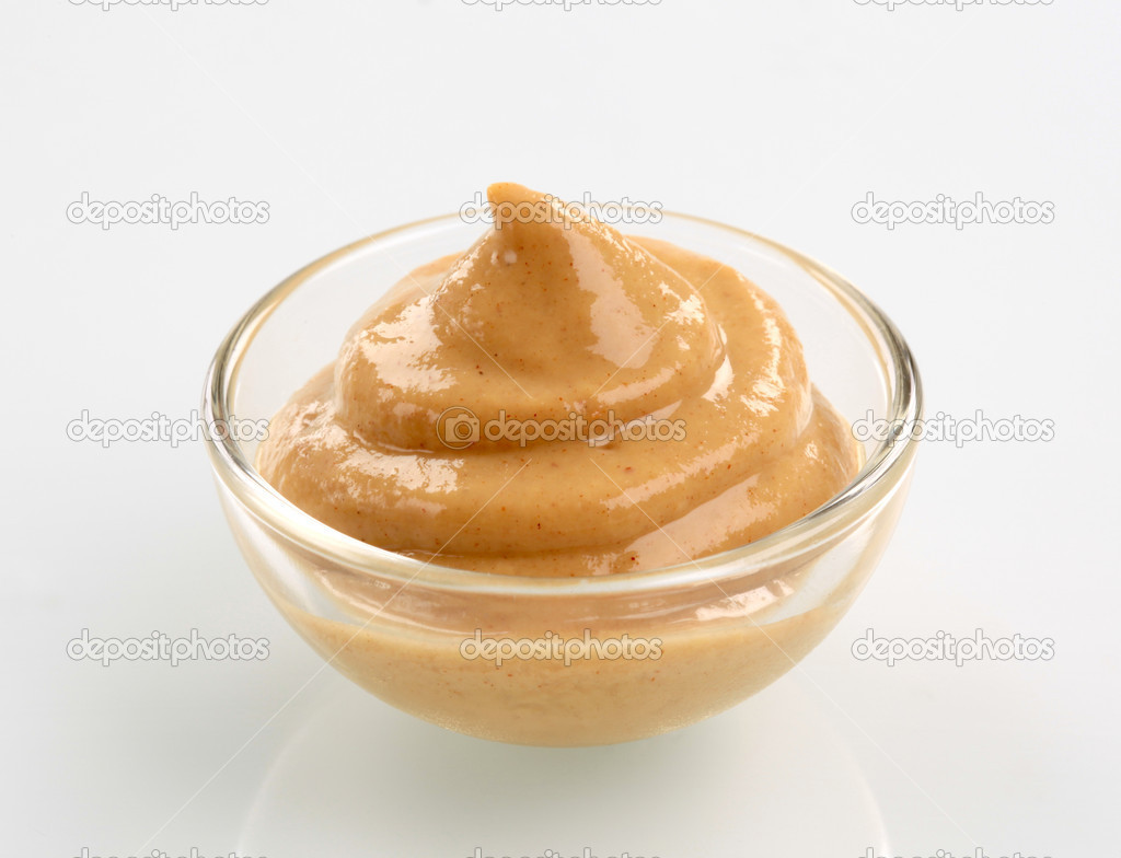 Swirl of spicy mustard in a bowl — Stock Photo #3285212