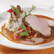Royalty-Free Stock Photo: Pork loin with rice and sauce