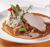 Pork loin with rice and sauce — Stock Photo