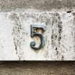 Block number on a wall - Stock Photo