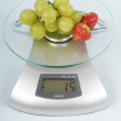 Fruit on a kitchen scale — Stock Photo