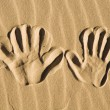 Hand prints in the sand — Stock Photo