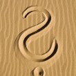 Question mark in the sand - Stock Photo