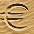 Stock Photo: Euro sign in sand
