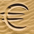 Euro sign in the sand — Stock Photo