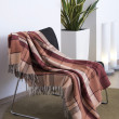 Plaid draped over a chair — Stock Photo
