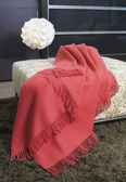 Throw draped over an ottoman — Stockfoto