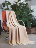 Throw draped over a chair — Stock Photo