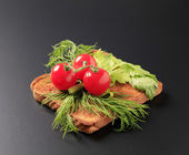 Dill and tomatoes on toast — Stock Photo