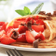 Crepes with curd cheese and strawberries — Stock Photo