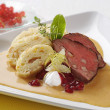 Sirloin of beef with cream sauce and dumplings — Stockfoto