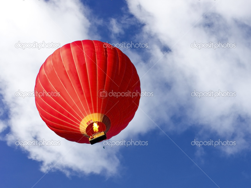 A red hot air balloon in a summer sky  Stock Photo #2764764