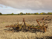 Harrows in a plowed field — Stock Photo