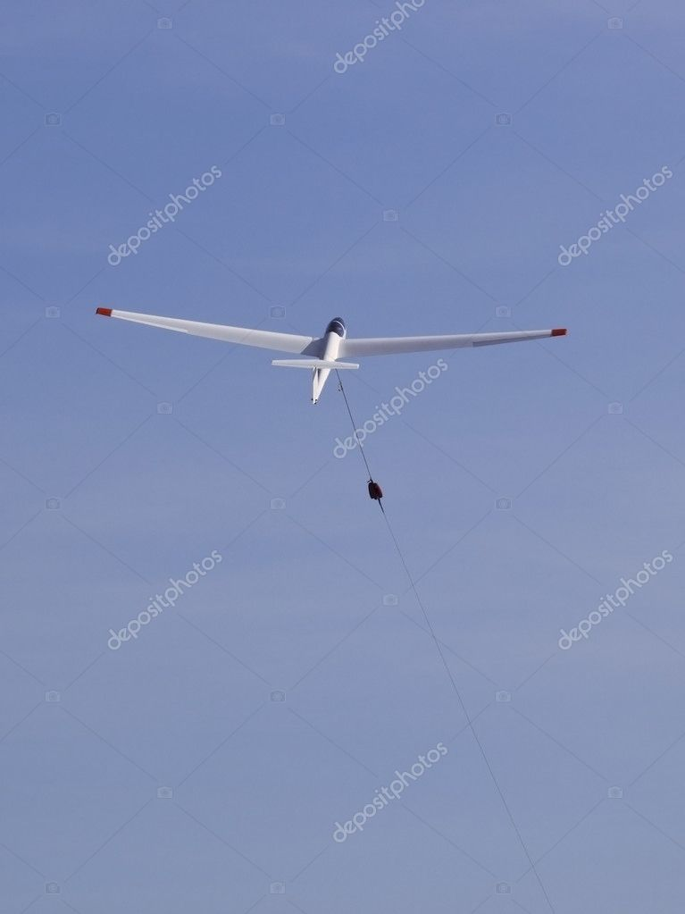A glider being launched by a winch cable — Stock Photo #2799186
