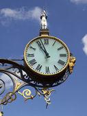 Ornamental clock in city — Stock Photo