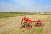 Landscape with hay turning equipment — Stock Photo