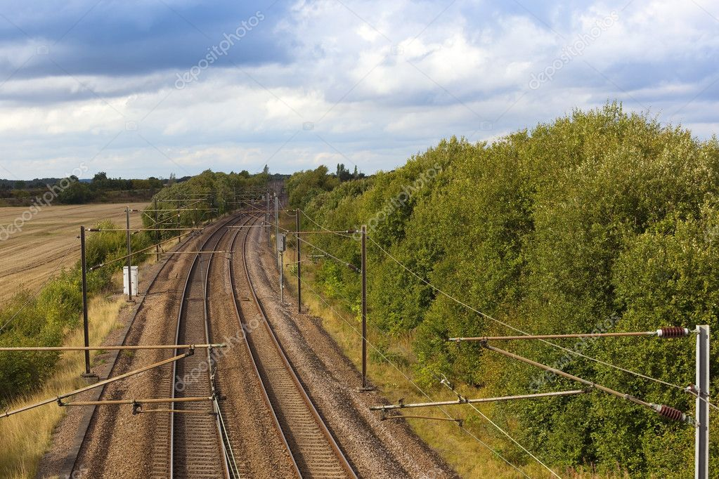 A rural landscape with an electrified railway track — Stock Photo #3849288