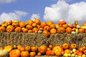 Pumpkins on bales of straw (hay) — Stock Photo