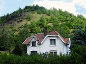 Little white house near the mountains — Stock Photo