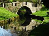 Medieval bridge in the park — Stock Photo
