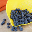 Fresh blueberries and strainer. — Stock Photo