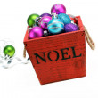 Christmas ornaments in a wooden box — Stock Photo