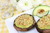 Avocado and walnut stuffed portabellas — Stock Photo