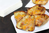 Baked potato skins and cheese — Stock Photo
