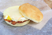Bacon, egg cheese sandwich to go — Stock Photo