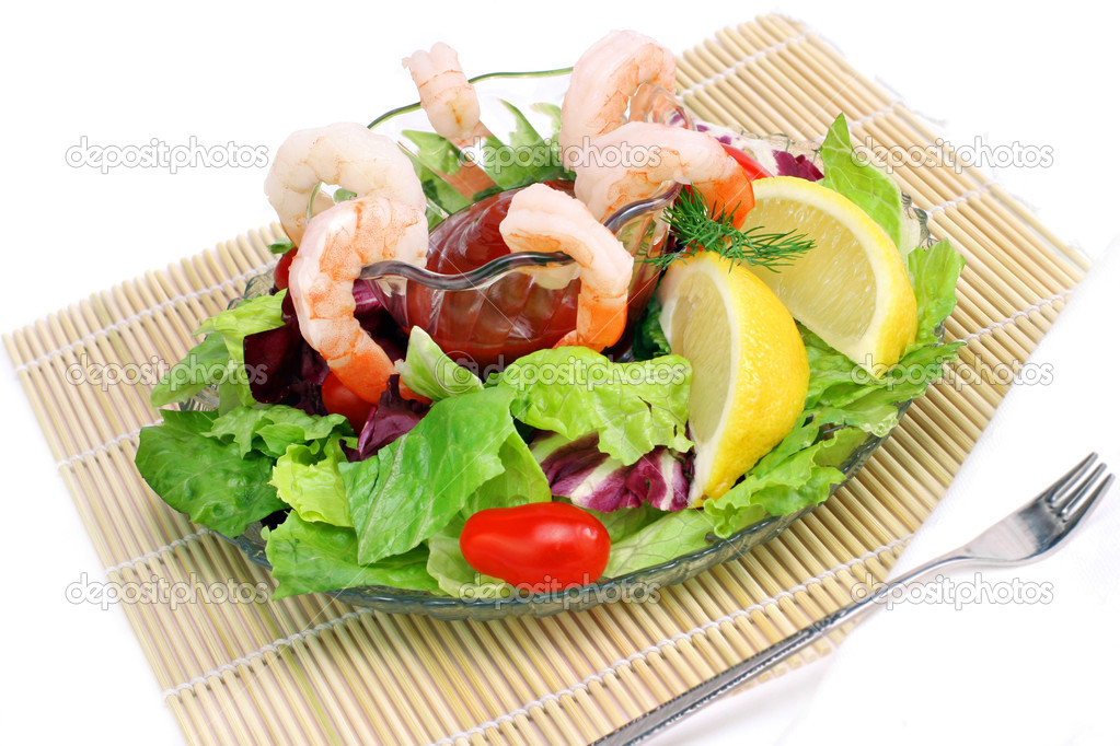 Shrimp cocktail on wooden mat, copy space. — Stock Photo #2705802