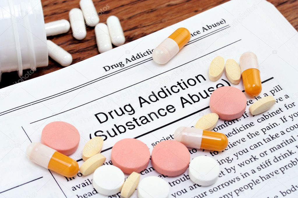 Information on drug addiction or substance abuse with varius pills scattered over the page.Close up macro shot. — Stock Photo #2705816