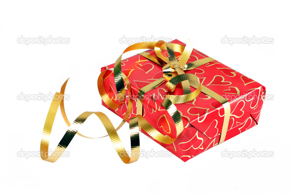 Beautiful gift wrapped in hearts and gold ribbons, isolated on white with copy space.  Perfect for Valentine's Day or Christmas. — Stock Photo #2706018