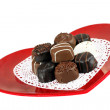 Heart shaped plate of chocolate candy - Stock Photo