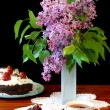 Stock Photo: Lilacs, cake and tea
