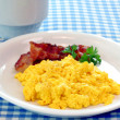 Scrambled eggs and bacon - Stok fotoğraf