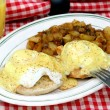 Stock Photo: Eggs beneditc and home fries