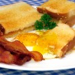 Bacon, eggs and toast - Stock Photo