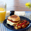 English muffine, egg, cheese breakfast. - Stock Photo
