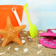 Childs bucket and a starfish - Stockfoto