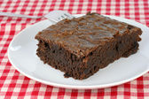 Fudge brownie on white plate — Stock Photo