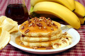 Pancakes with walnuts and bananas — Stock Photo