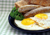 Sunny Side Up Eggs and Sausage — Stock Photo