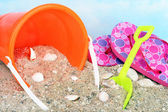 Childs bucket, toys in sand — Stok fotoğraf