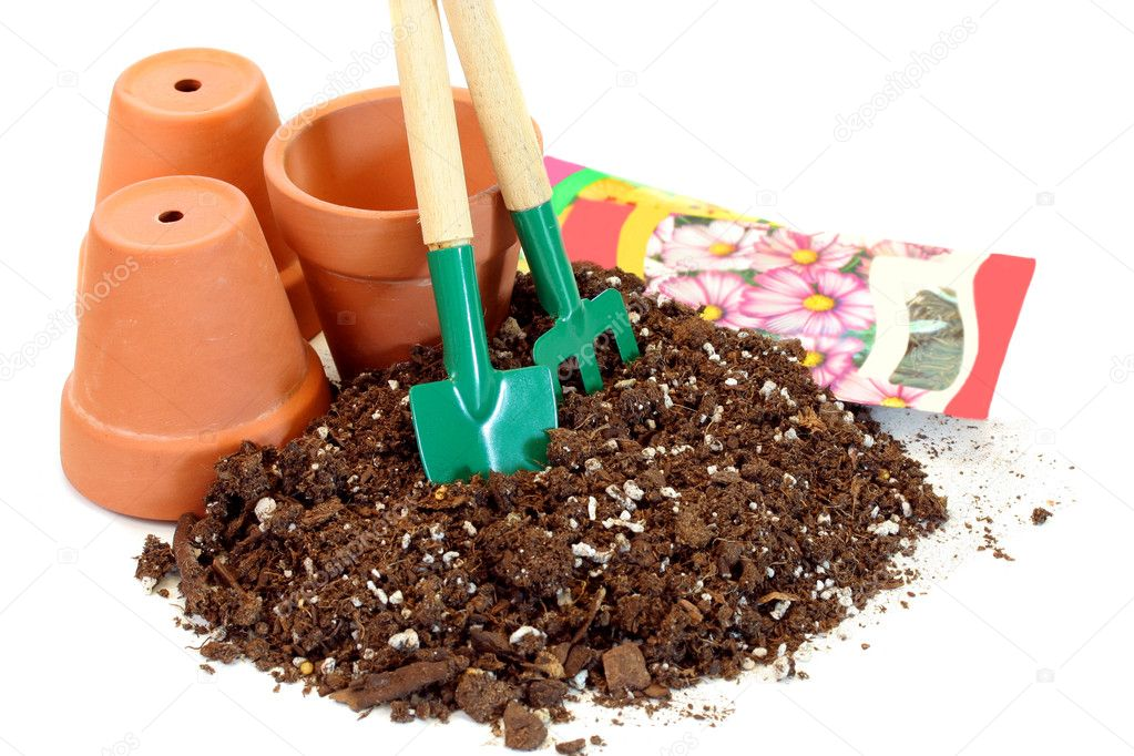 Clay pots seeds soil and garden tools stock photo for Clay potting soil