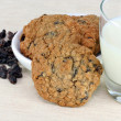 Oatmeal raisin cookies and milk - Stock Photo