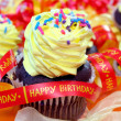 Birthday cupcake and ribbons — Stock Photo